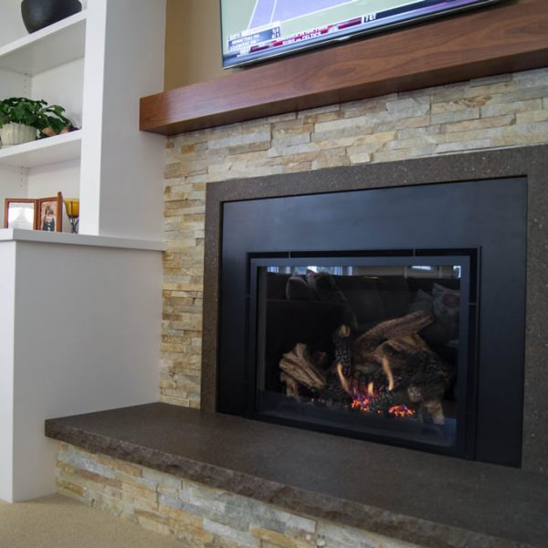closeup of fireplace with white built-in cabinetry