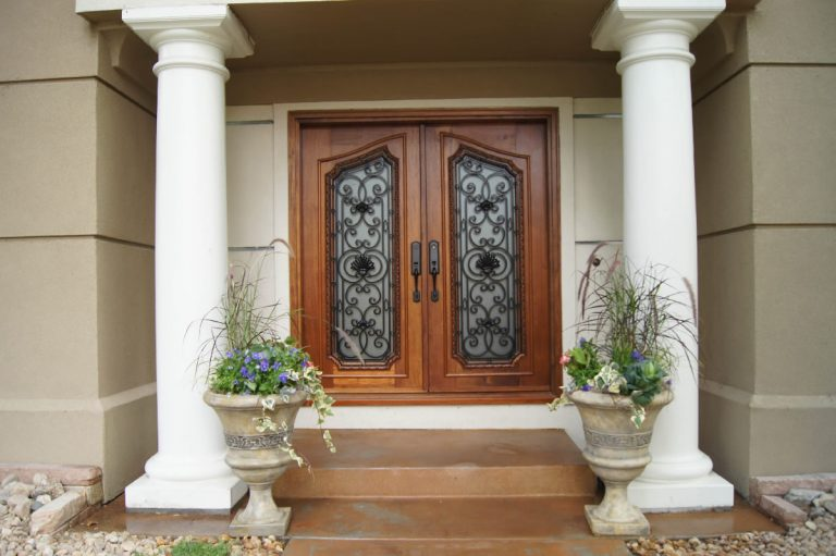 entry remodel - home front entry with a Honduran Mahogany door