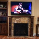 overview of fireplace and built-in cabinet in alder