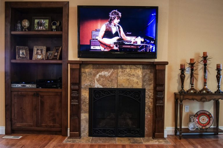 Denver Fireplace Remodel - overview of fireplace and built-in cabinet in alder