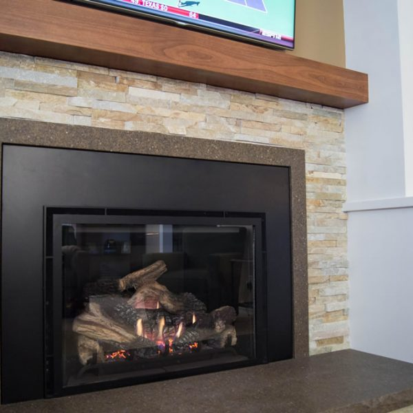 closeup of fireplace with stacked stone surround
