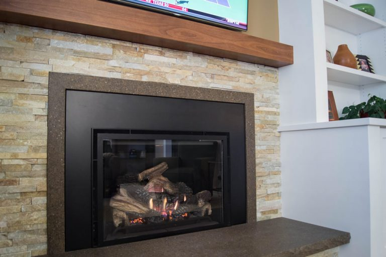 Centennial Family Room Remodel - closeup of fireplace with stacked stone surround