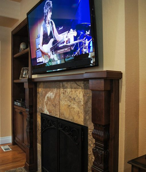 fireplace with tile surround and custom alder mantle