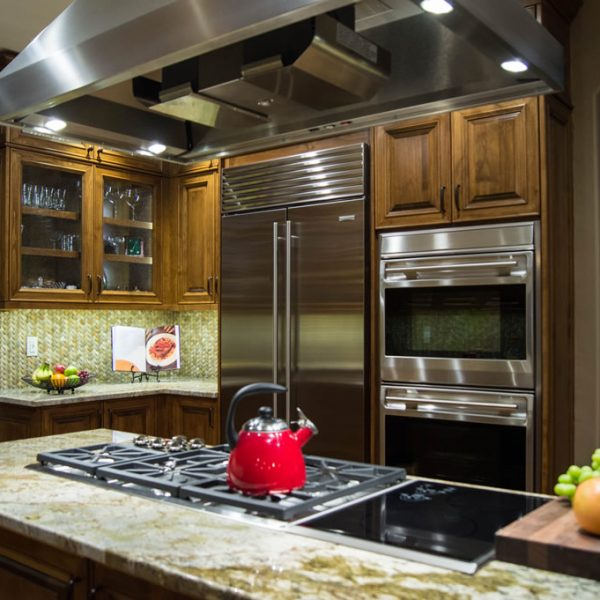 custom-alder-kitchen-cabinetry-wolf-induction-range-cooktops-wolf-double-builtin-ovens-subzero-french-door-food-preservation