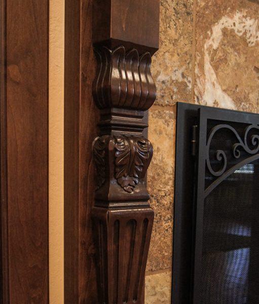 detail of custom carved alder mantle leg