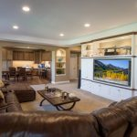 custom entertainment center in white painted cabinetry with walnut trim