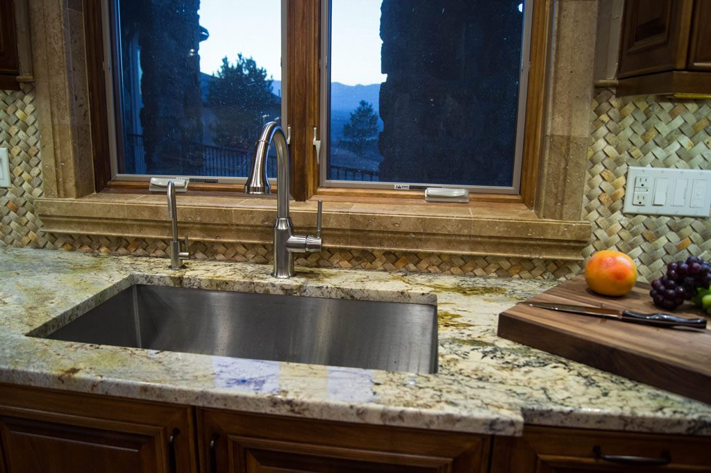 kitchen-sink-detail-typhoon-bordeaux-granite-countertop