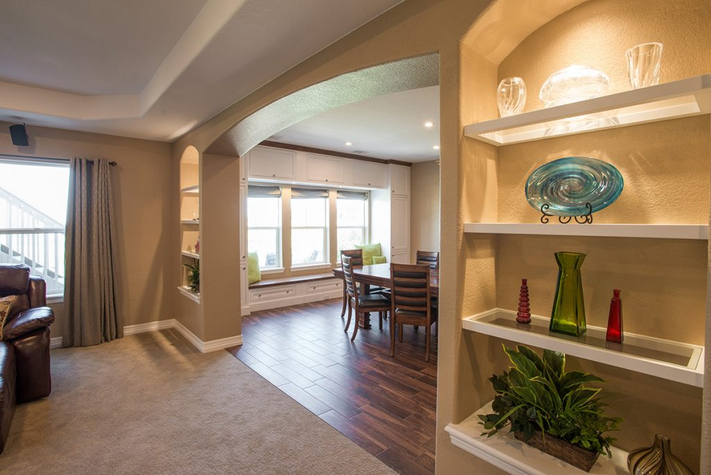 custom built-in niches with glass shelving and custom window seat