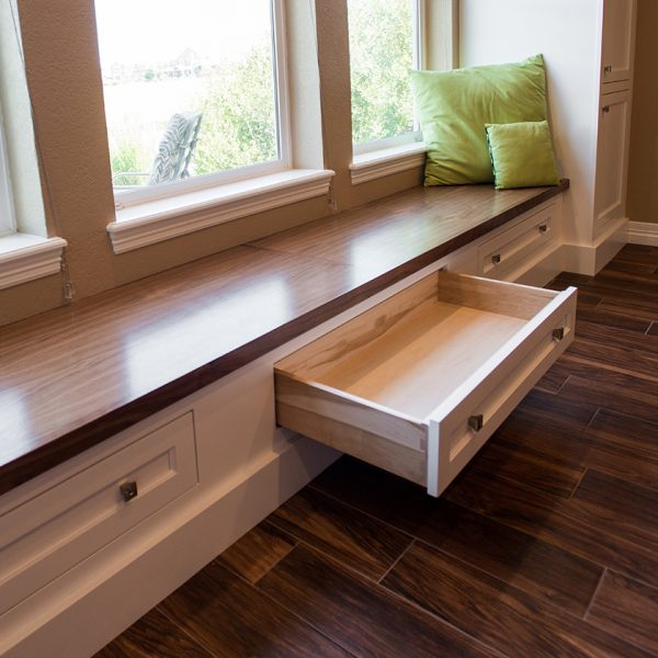 custom walnut window seat with drawers for storage underneath