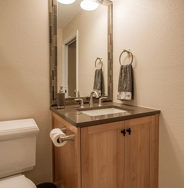 custom alder bathroom vanity with quartz countertop and tile mirror frame