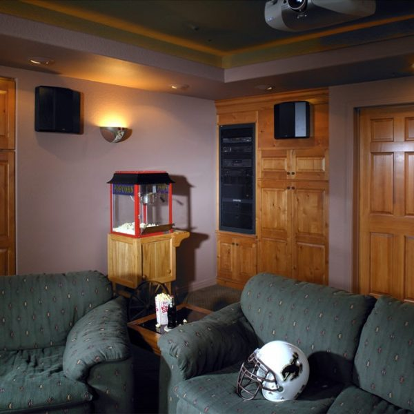 basement theater finish with custom entertainment center cabinetry