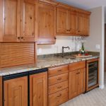 basement wet bar remodel with custom cabinetry