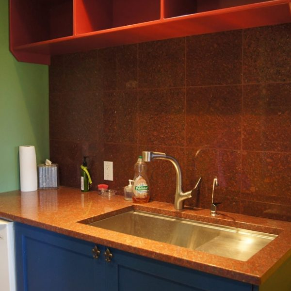 custom colorful mudroom cabinetry and mudroom sink