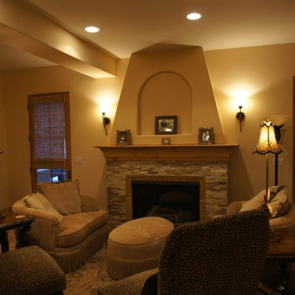 fireplace with stone surround and custom mantel