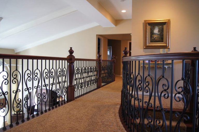 A Grand Entrance - custom cherry staircase remodel