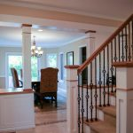 custom white and alder dining room cabinetry and matching staircase