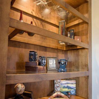 closeup of custom alder cabinetry glass shelving