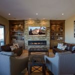 overview of family room custom cabinetry with 70-inch linear fireplace and stacked stone surround