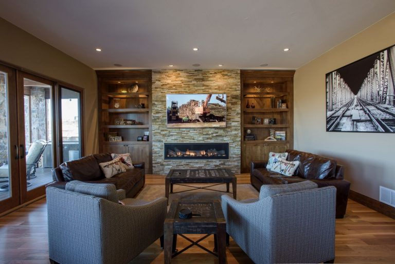 Littleton Family Room Remodel - overview of family room custom cabinetry with 70-inch linear fireplace and stacked stone surround