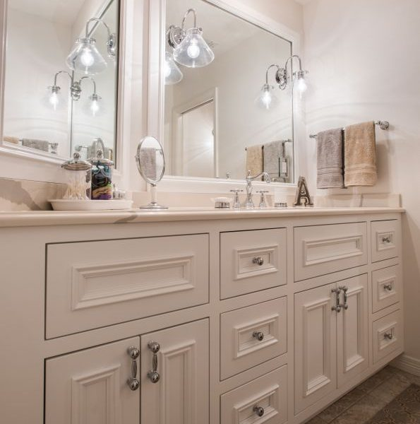 custom white painted bathroom vanity and custom white painted mirror frames