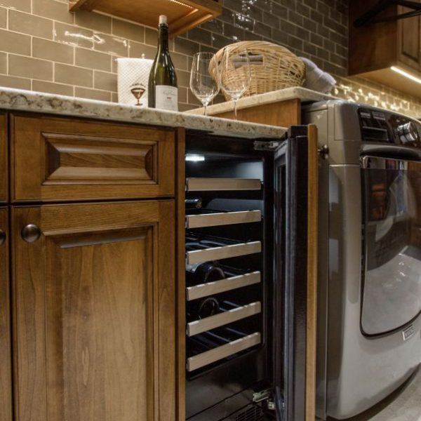 butler's pantry with custom alder cabinetry and wine cooler