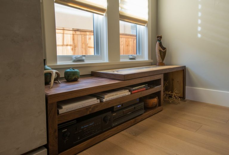 custom walnut and beetle kill entertainment center with adjustable top in denver