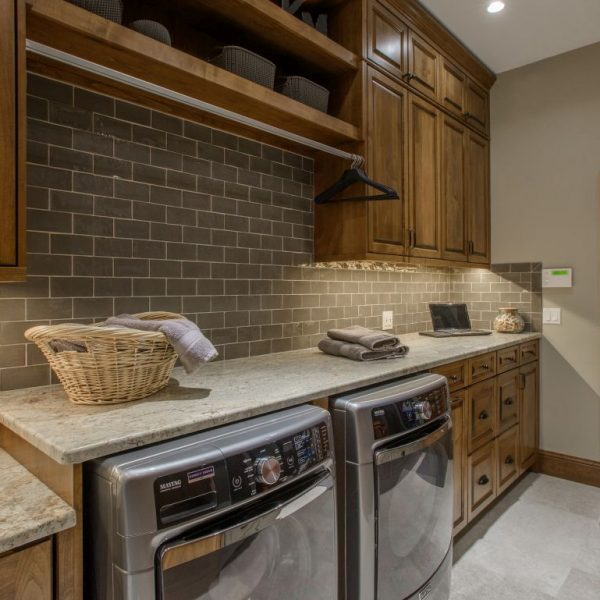 laundry room with custom alder cabinetry