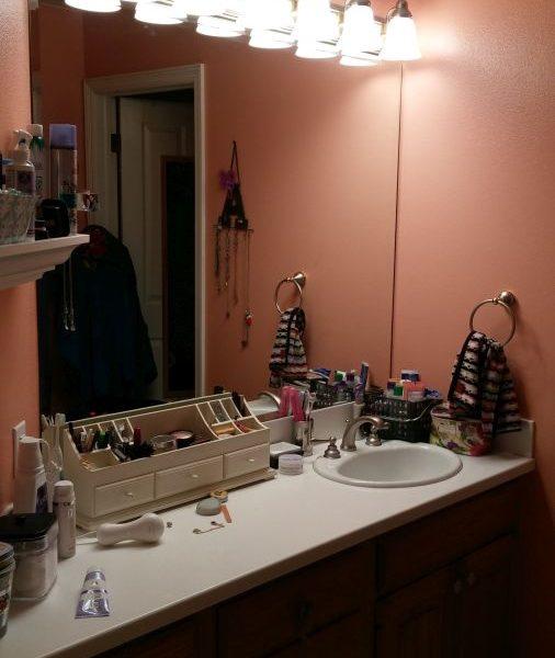 before photo of dark cramped bathroom