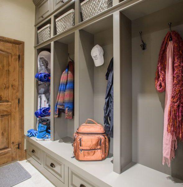 grey painted built-in cubbies and storage in custom mudroom remodel