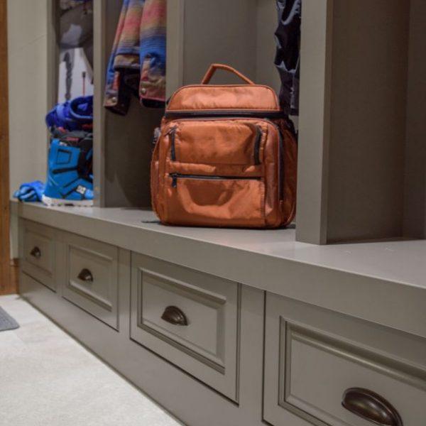 grey painted built-in cubbies and drawers in custom mudroom remodel