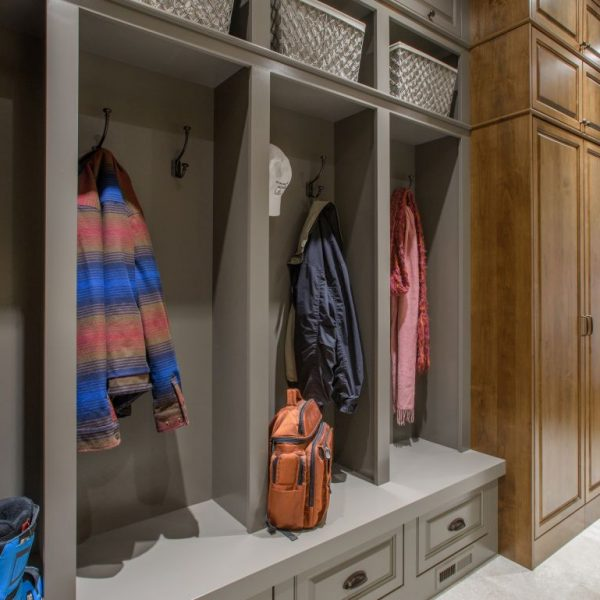grey painted built-in cubbies and alder cabinetry in custom mudroom remodel